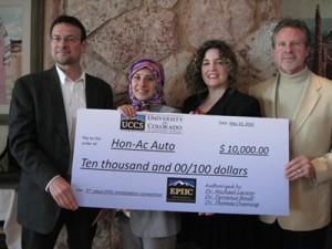 Hon-Ac Auto L-R Randy Schillinger, owner, student Zahra Befhar, student Jennifer Nail, and Dan Kane, owner